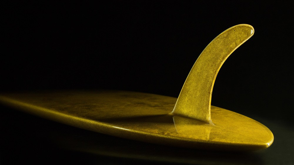 THE WORLD'S FIRST 24 KT GOLD SURFBOARD